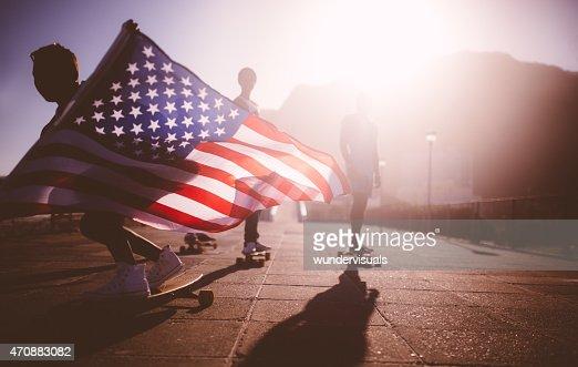 African American longboarder flying an American flag