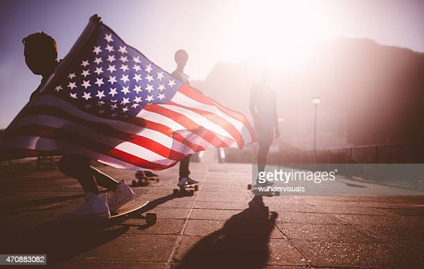 African American longboarder flying an American flag