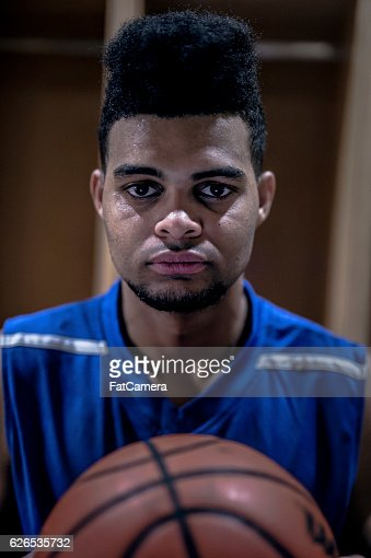 African American male basketball star looking intense before the game