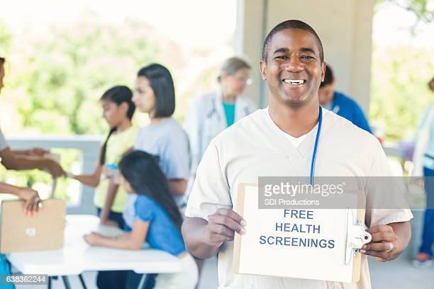 African American male nurse promotes community health fair