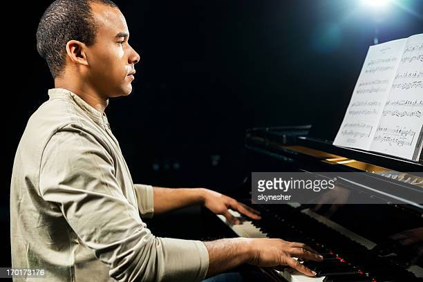 African American male pianist.