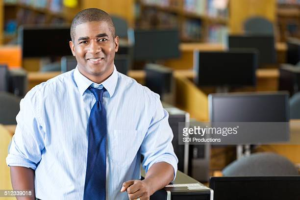 African American male teacher standing in computer lab