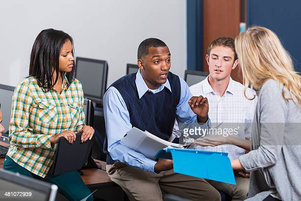 African American male teacher with students in class