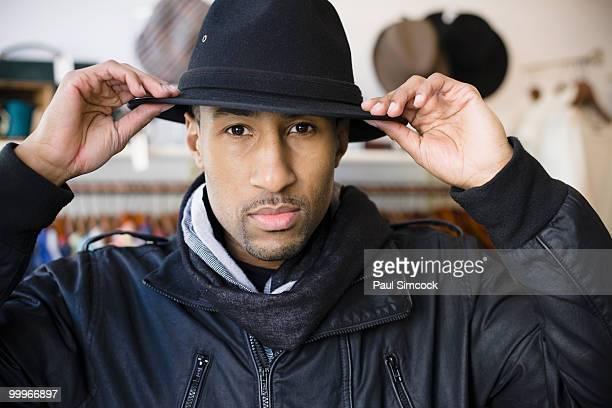 African American man adjusting fedora