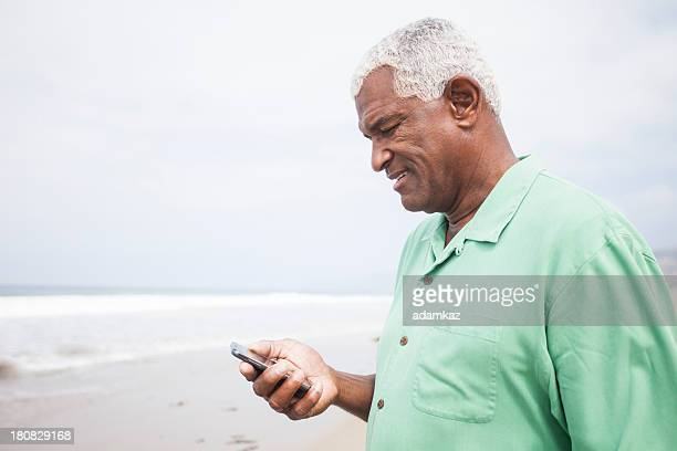 African American Man Checking Smartphone