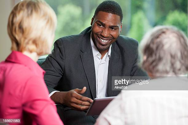 African american man consulting with clients