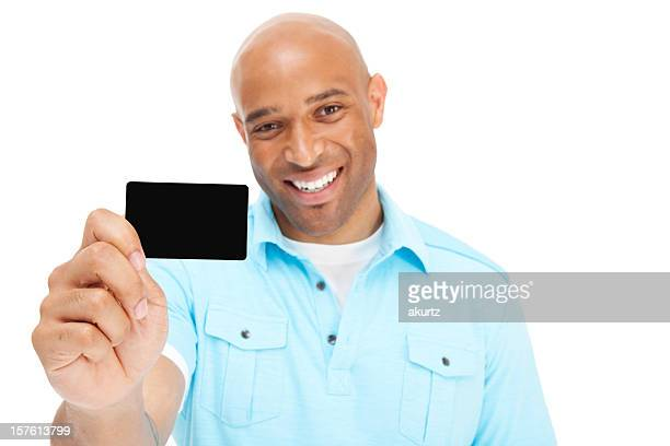 African American man displaying credit card bright smile