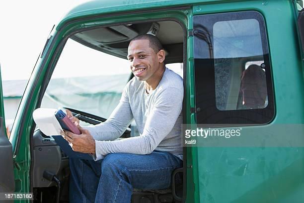 African American Mann driving truck