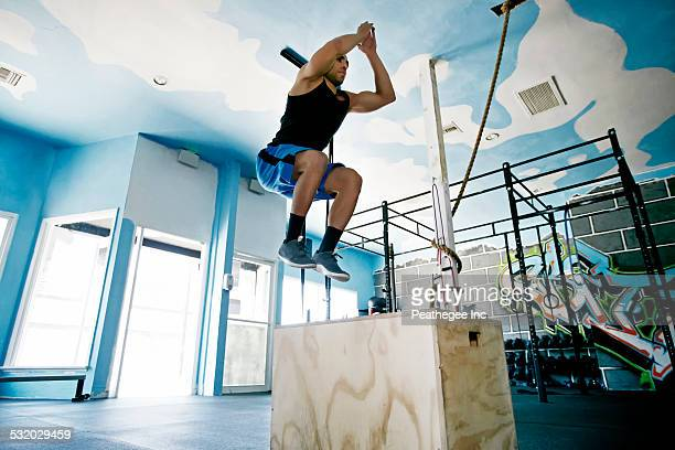 African American man exercising in gym