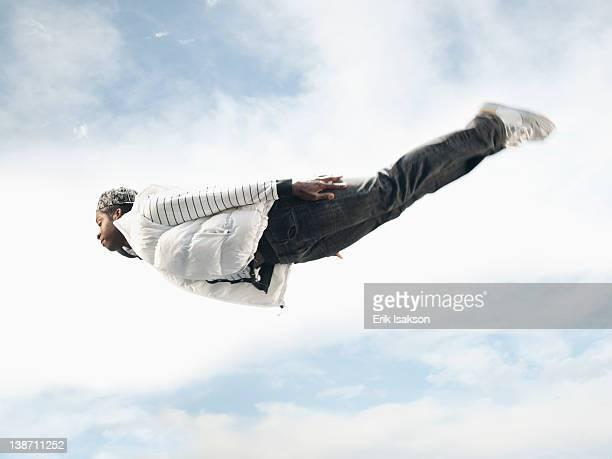 African American man flying through mid-air