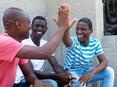 African american man give high five outdoor in the summer in the city