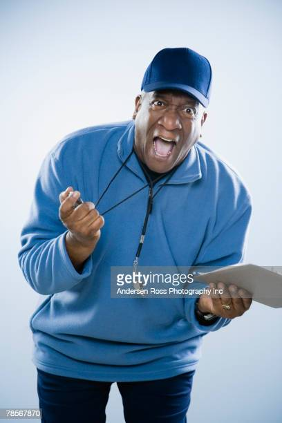 African American man holding stopwatch