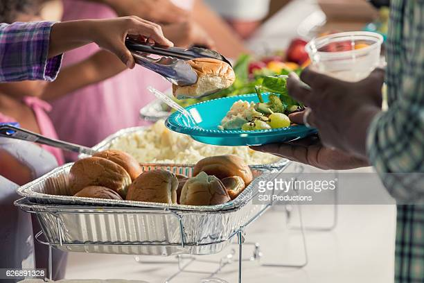 African American man is served a meal in soup kitchen
