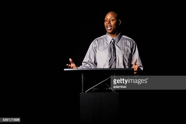 African American Man Making a speech at a podium