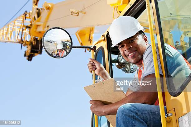 African American man operating a crane