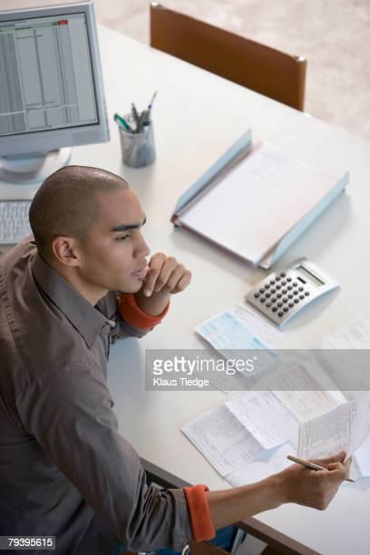 African American man paying bills online