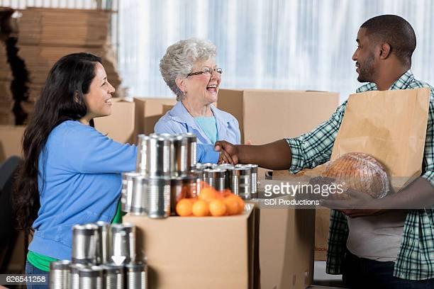 African American man picks up food at food bank