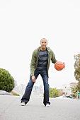 African American man playing basketball