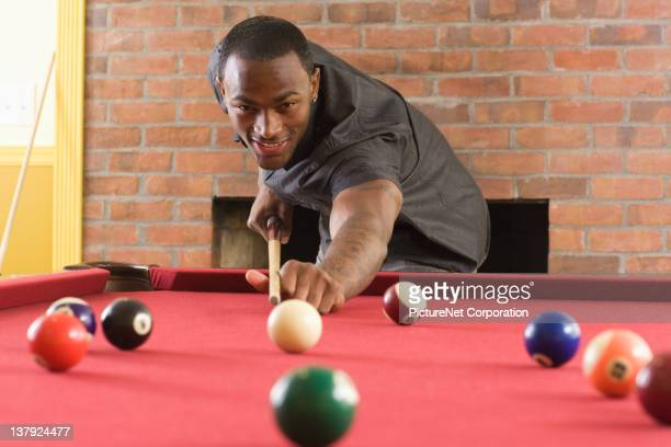 African American man playing pool