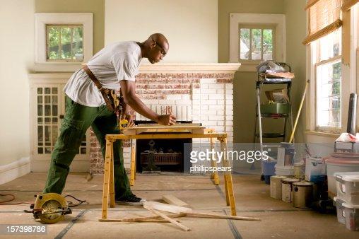 African American man renovating home interior.