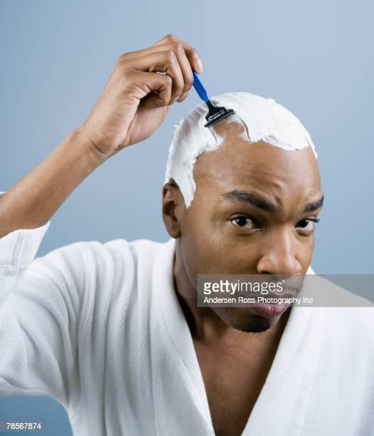 African American man shaving head