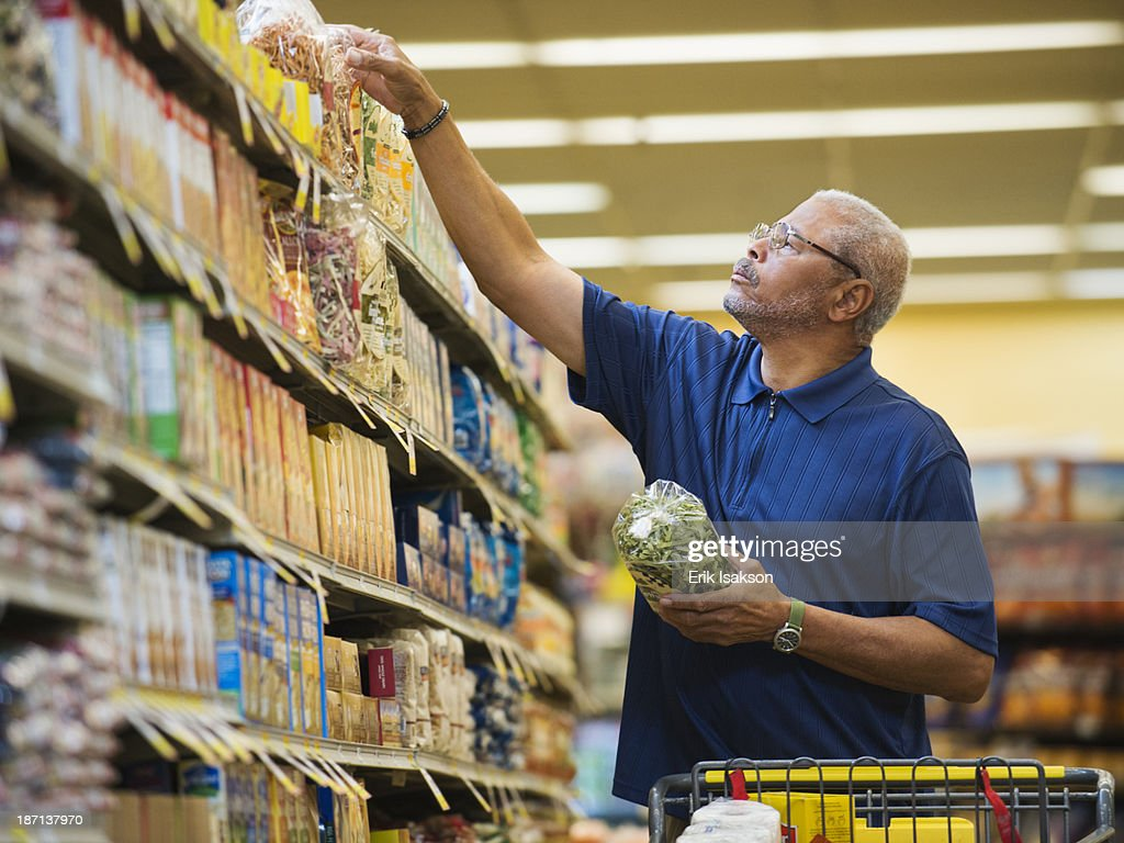 African American man shopping in grocery store : Stock Photo