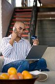 African American man shopping online