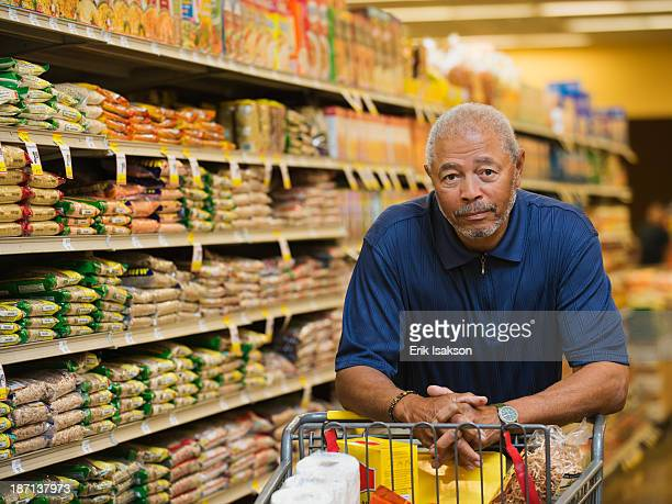 African American man smiling in grocery store