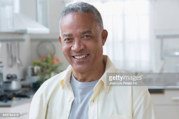 African American man smiling in kitchen