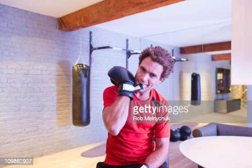 African American man taking off boxing gloves. : Stock Photo