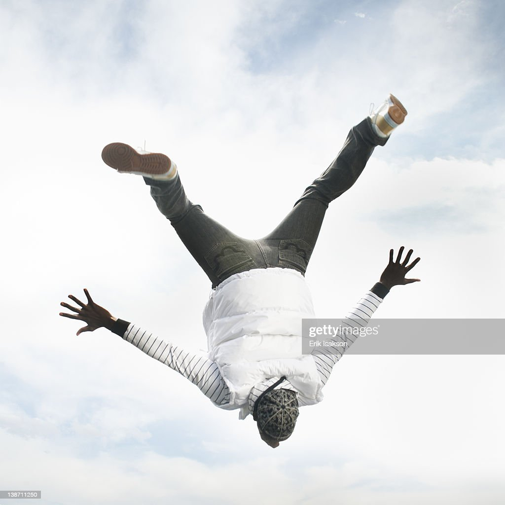 African American man upside-down in the air : Stock Photo