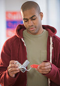 African American man viewing price tag on video camera