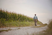 African American man walking on remote path