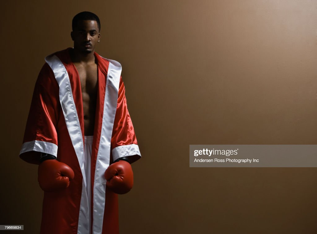 African American man wearing boxing gloves : Stock Photo
