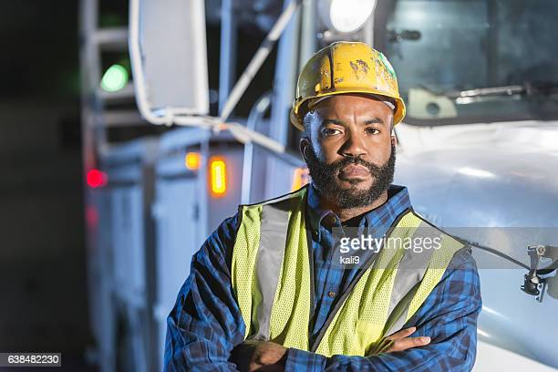 African American man with cherry picker truck