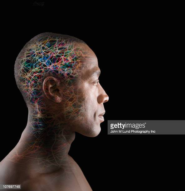African American man with colorful wires in head