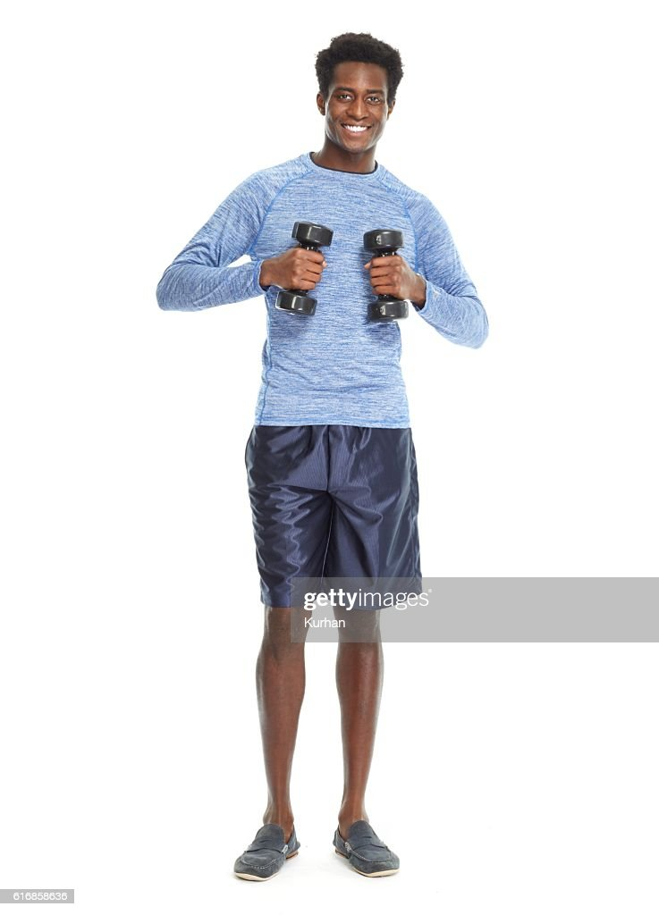 African American man with dumbbells. : Stock Photo