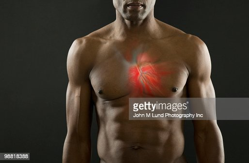African American man with glowing heart : Stock Photo