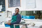 African American man working in fish market