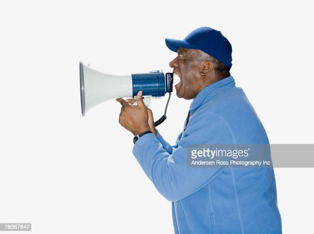 African American man yelling into megaphone