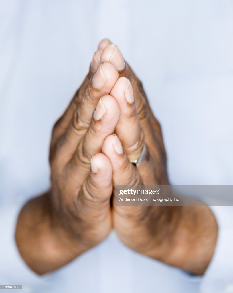 African American man's hands in prayer position