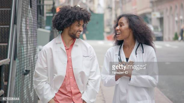 African American Medical Professionals Walk Together