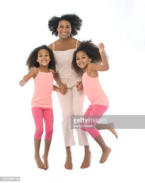 African American Mom & Daughters Jumping.