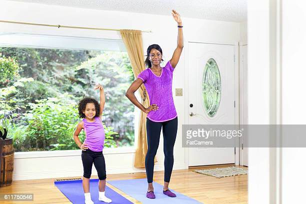African American mother and daughter exercising together