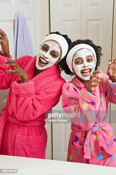 african american mother and daughter with skin cre