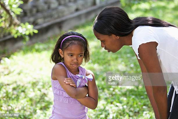 African American mother disciplining daughter