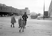 African American mother walking with children to distant school re segregation of elementary grade students throughout the state prompting famed...