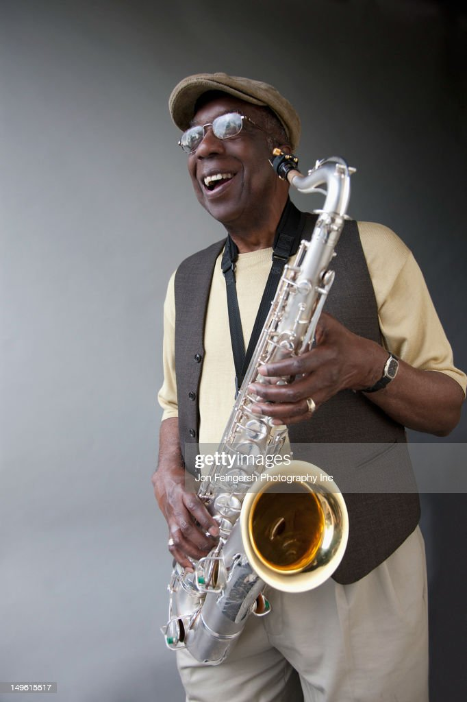 African American musician holding saxophone