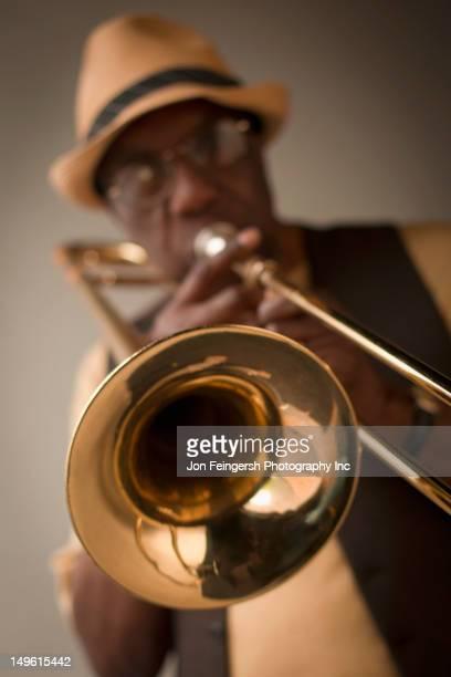 African American musician playing trombone