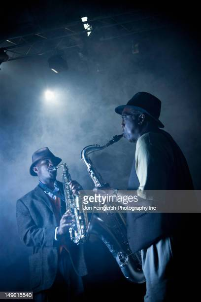 African American musicians playing in jazz band on stage